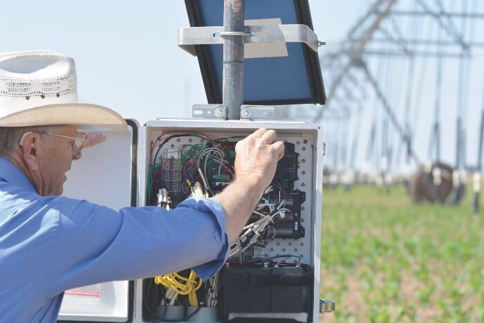 Thomas Marek makes adjustments to the CPACS sprinkler system.